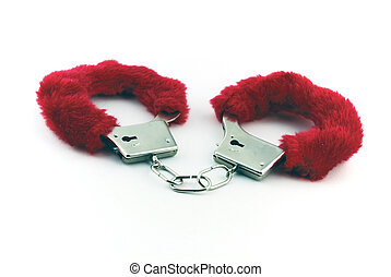 Handcuffs - A pair of handcuffs with red fur on them and set...