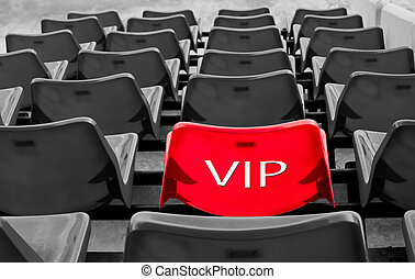 red vip seat in football stadium - many black and red vip...