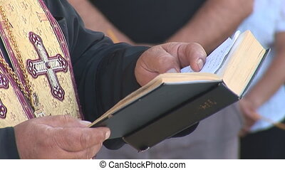 priest 1 - priest reads the Bible