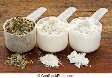 hemp and whey protein powder - plastic measuring scoops of...