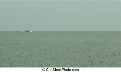 Fishing Trawler in Hazy Sea - footage of a fishing trawler...