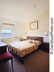 Hotel bedroom for one - Interior of a room in a hotel,...