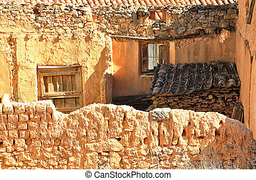 people gabled houses built of adobe and mud