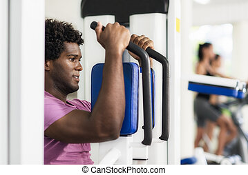 Young african american man training in fitness gym - Young...
