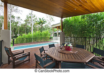 Outdoor entertaining area - Modern backyard with...