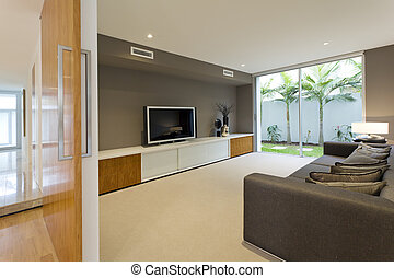 Luxury media room - Luxurious media room with Tv and couch