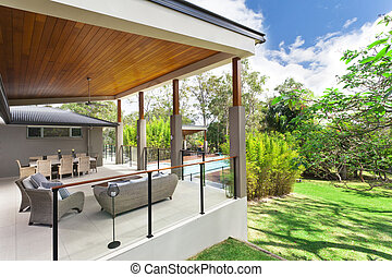 Modern backyard with entertaining area in stylish Australian...