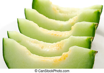 Neatly arranged melon - Neatly arranged cut melon on the...