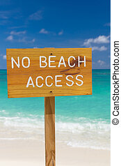 No beach access sign on beautiful background of sea, sky and...