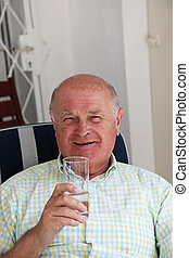 Healthy happy pensioner drinking water - Healthy happy...