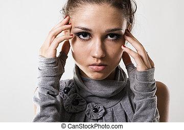 Beautiful young fashion model studio photo