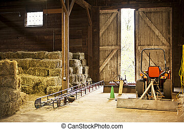 Barn interior with hay bales and farm equipment - Interior...