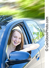 Teenage girl learning to drive - Teenage female driving...