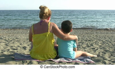 Mother and son in the beach