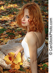 Beautiful woman in yellow leaves - Beautiful redhead woman...