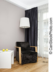 room with lamp and chair