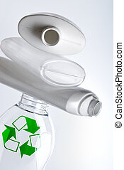 plastic recycling - empty plastic bottles with recycle...