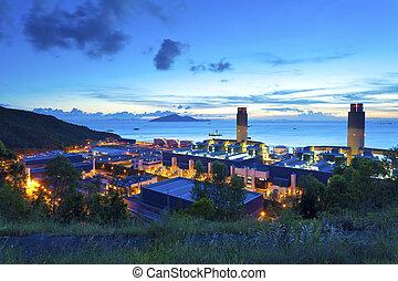 Sunset at power plant along the coast in Hong Kong