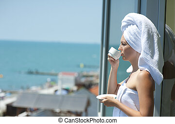 Young woman drink coffe from cup - Young woman drink coffe...