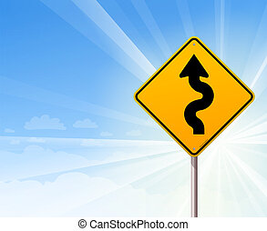 Winding road sign on blue sky - Yellow sign with winding...