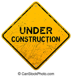 Dirty Under Construction Sign - Aged yellow roadsign with...