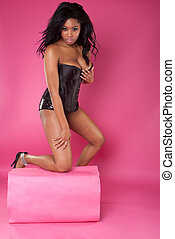 sexy woman on pink wearing corset