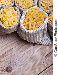 Assorted pasta in burlap bags