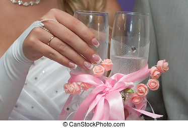 Bride holds a glass with champagne - The hand of the bride...