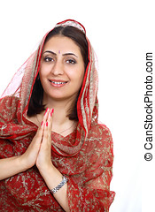 Namaste greeting by a graceful indian female