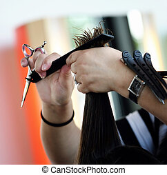 Haircut - Hands of harrdresser triming hear