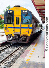 Thai yellow train in station - Thai train stop at station...