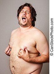 Man pleasuring his own nipples - Funny picture of an...
