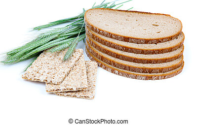 tasty baked bread, crispbread, ears and wheat grain, isolated on a white background