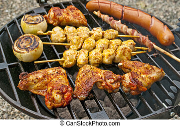 barbecue with chicken wings, Bratwurst, meat skewer and ham