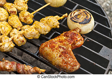 barbecue with chicken wing, meat skewer and ham