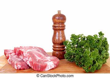 pork chop on cutting board