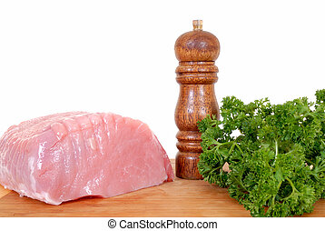 Tenderloin pork roast on cutting board - Tenderloin pork...