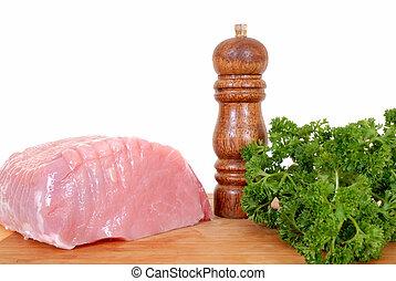 Tenderloin pork roast on cutting board - Tenderloin pork...