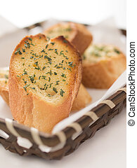 garlic bread - close up of a basket of garlic bread