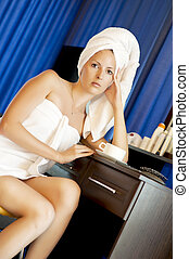 Young sexy woman in white towels