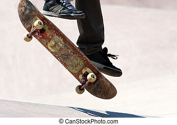 Skateboarder Jumping Tricks - Close up of a skateboarders...