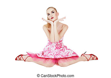 Musing - Beautiful blond girl in stylish pink dress sitting...