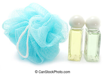 Shampoo, conditioner and bath sponge on a white background