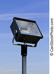 Flood light - A flood light on blue sky in front of an...