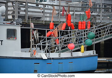 Lobster boat - A lobster boat at the dock getting ready to...