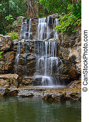 Tropical waterfall in forest - Tropical waterfall in...