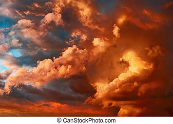 Very dramatic sunset cloudscape with fascinating shapes and...