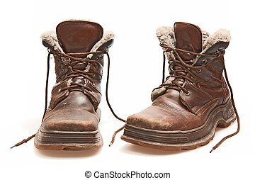 boots - old brown boots isolated on white
