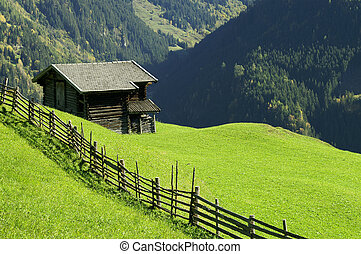 Fence and Stable - An olde fence and a stable in the Alps