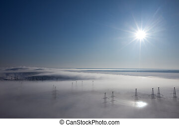 Winter landscape fog over earth top view